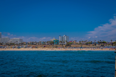 Los Angeles, California, USA, JUNE, 15, 2018: Outdoor view of Santa Monica State Beach, in the back residential buildings, Santa Monica Pier and the mountains Editorial