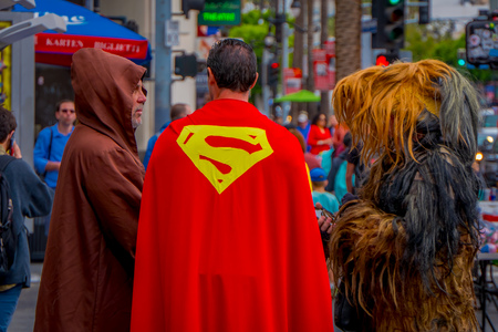Los Angeles, California, USA, JUNE, 15, 2018: Outdoor view of unidentified people wearing different costumes, a superman, chewbacca and jedi in the streets of Los Angeles in Hollywood Stockfoto - 120296795
