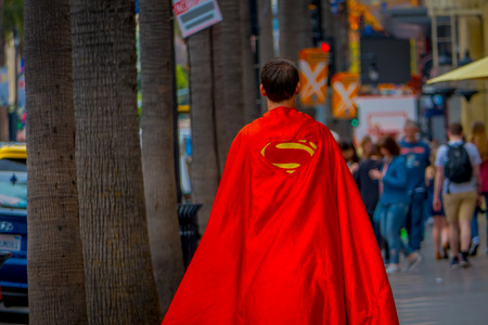 Los Angeles, California, USA, JUNE, 15, 2018: Outdoor view of unidentified man wearing a superman costume and walking in the streets of Los Angeles in Hollywood Stockfoto - 120296798