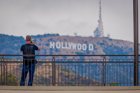 Los Angeles, California, USA, JUNE, 15, 2018: Unidentified man taking pictures of the world famous landmark Hollywood Sign in Los Angeles, California