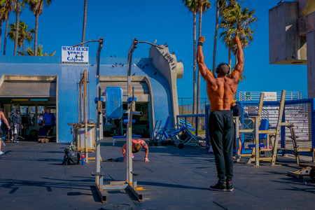 Los Angeles, California, USA, JUNE, 15, 2018: Muscle Beach gym on Venice Beach, muscle Beach is a landmark, outdoor gym dating back to the 1930s where celebrities and famous bodybuilders trained