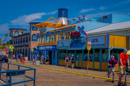 Los Angeles, California, USA, JUNE, 15, 2018: Outdoor view of people walking at the pier of Santa Monica Pier, at the end of Route 66. The amusement park is a world famous tourist attraction
