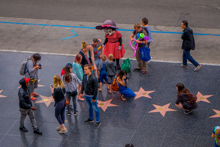 Los Angeles, California, USA, JUNE, 15, 2018: Above view of unidentified tourists in walk of fame in Los Angeles. Hollywood Walk of Fame features more than 2,500 stars with inscribed celebrity names
