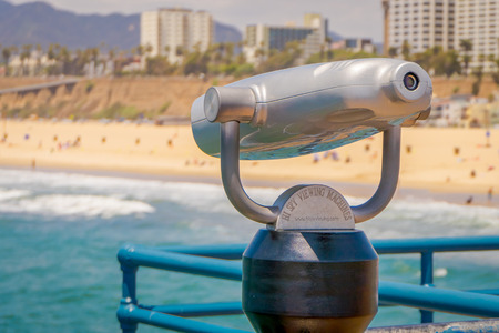 Los Angeles, California, USA, JUNE, 15, 2018: Close up of coin operated optical binocular, in Santa Monica pier with a blurred city background Editorial
