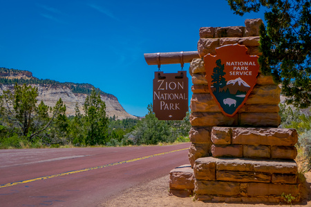 SPRINGDALE, UTAH, USA - JUNE, 12, 2018: Outdoor view of east entrance to Zion National Park Sign Utah