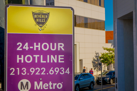 Los Angeles, California, USA, AUGUST, 20, 2018: Outdoor view of informative sign of Metro logo hotline, LA Metro is the public rail and bus transportation system in Los Angeles 報道画像