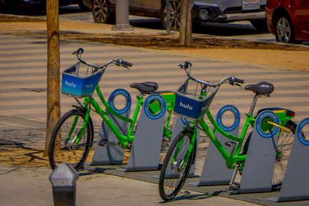 Los Angeles, California, USA, JUNE, 15, 2018: Outdoor view of green bicycles parked at outside at Venice Beach in Santa Monica, popular by domestic residents for relaxing and sporting Editorial