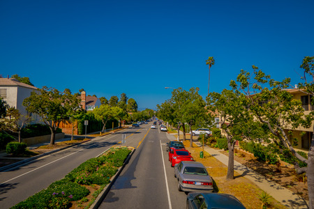 Los Angeles, California, USA, JUNE, 15, 2018: Palm trees street in Beverly Hills and cars circulating in the roads of Los Angeles, California