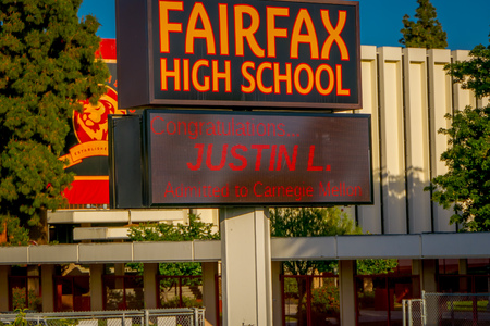 Los Angeles, California, USA, AUGUST, 20, 2018: Outdoor view of informative light sign of Fairfax High School in Los Angeles, in a beautiful sunny day