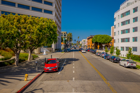 Los Angeles, California, USA, JUNE, 15, 2018: Outdoor view of caras parked at onde side of the streets of Beverly Hills, Los Angeles, California in USA. Editorial