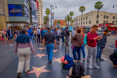 Los Angeles, California, USA, JUNE, 15, 2018: Outdoor view people visit walk of fame in Los Angeles. Hollywood Walk of Fame features more than 2,500 stars with inscribed celebrity names