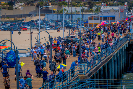 Los Angeles, California, USA, JUNE, 15, 2018: Crowd of unidentified tourists walking in the wooden pier by the Santa Monica, amusement park in California Editorial