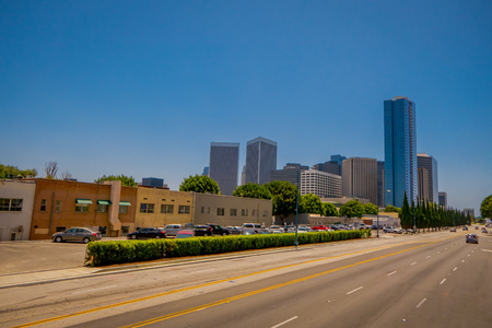 Los Angeles, California, USA, JUNE, 15, 2018: Outdoor view of cars in a highway surrounding of huge buildings in a gorgeous beautiful day with blue sky in Los Angeles downtown