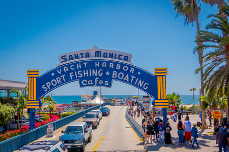 Los Angeles, California, USA, JUNE, 15, 2018: Beach goers at the Santa Monica Pier on Ocean Aven in Santa Monica, California. The city has 3.5 miles of beaches and 340 days of sunshine a year