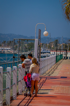 Los Angeles, California, USA, AUGUST, 20, 2018: Outdoor view of unidentified tourists in Santa Monica beach in Los Angeles, United States. Santa Monica is a beachfront city in western Los Angeles County