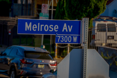 Los Angeles, California, USA, AUGUST, 20, 2018: Outdoor view of Melrose avenue sign with palm trees in Hollywood, California Editorial