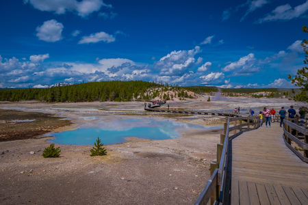 YELLOWSTONE, MONTANA, USA JUNE 02, 2018: Unidentified people taking pictures and enjoying the Pools of colorfully colored water dot of the Norris Geyser Basin in Yellowstone National Park Editorial