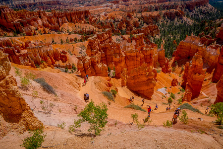 BRYCE CANYON, UTAH, JUNE, 07, 2018: Hikers in Bryce Canyon hiking in beautiful nature landscape with hoodoos, pinnacles and spires rock formations. Bryce Canyon National Park, Utah, USA in summer Editorial