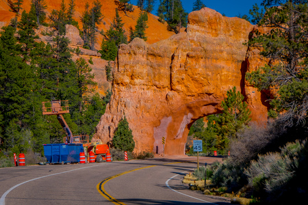 BRYCE CANYON, UTAH, JUNE, 07, 2018: Outdoor view of machinery located at one side of the road before of red arch road tunnel on the way to Bryce Canyon National Park, Utah Editorial