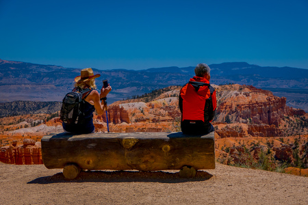 BRYCE CANYON, UTAH, JUNE, 07, 2018: Unidentified people sitting and looking at landscape in Bryce Canyon national park, Utah Editorial