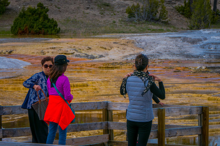YELLOWSTONE, MONTANA, USA MAY 24, 2018: Tourist taking pictures and enjoying trhe gorgeous day in Mammoth Hot Springs,Yellowstone National Park Editorial