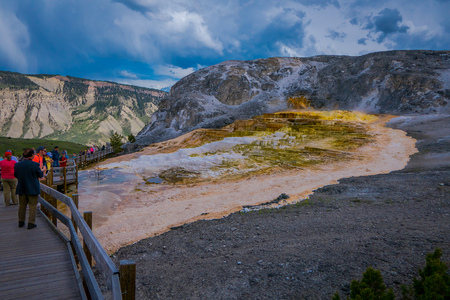 YELLOWSTONE, MONTANA, USA MAY 24, 2018: Unidentified people at Canary Springs on terraces of Mammoth Hot Springs in Yellowstone National Park, Wyoming Editorial
