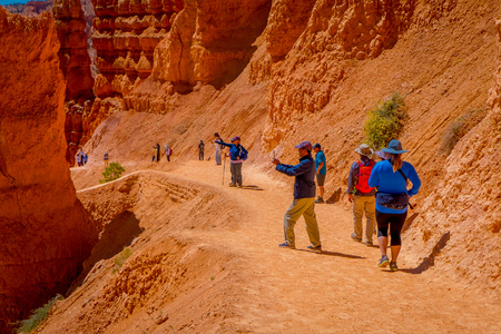 BRYCE CANYON, UTAH, JUNE, 07, 2018: Young Travelers standing on the cliff of Bryce Canyon National Park, Utah Editorial