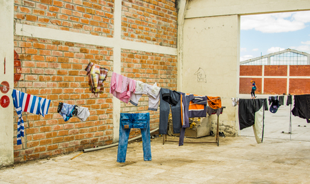 QUITO, ECUADOR, AUGUST 21, 2018: Colorful clothes are drying in the wind hanging in lines in sunny day