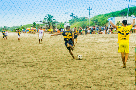 Manabi, Ecuador, May, 29, 2018: Group of friends having fun on the beach playing soccer. happy people and beach games concept