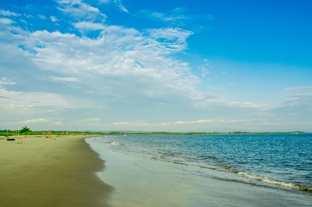 Beautiful outdoor vierw of empty tropical beach background. Horizon with sky and white sand in Cojimies, Ecuador.