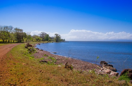 Beautiful outdoor view of seashore of the ocean at Isla Ometepe in Nicaragua. surrounding of nature in Ometepe island in sunny day.