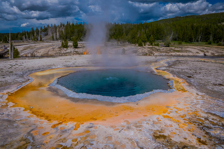 Crested pool hot spring and orange microbial mat in the old faithful geyser basin of Yellowstone National Park, Wyoming in Usa.