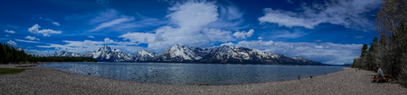Beautiful panoramic view of Jackson Lake with huge mountains covered with snow in Grand Teton National Park, Wyoming, Yellowstone, in Usa.