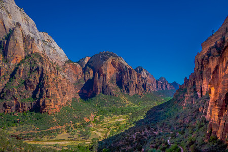 Panoramic view of famous Angels Landing, overlooking scenic Zion Canyon on a beautiful sunny day with blue sky in summer, Zion National Park, Springdale, southwestern Utah, USA