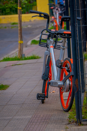 SANTIAGO, CHILE - SEPTEMBER 13, 2018: Bike parked at outdoors of the city in gorgeous beautiful sunny day i the dowtown of the city in Santiago, Chile Editöryel
