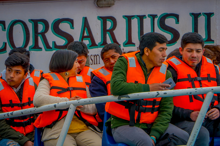 VALPARAISO, CHILE - SEPTEMBER, 15, 2018: Outdoor view of unidentified tourists wearing a life jacket inside of a tourist boat in Port of Valparaiso on the Pacific Coast