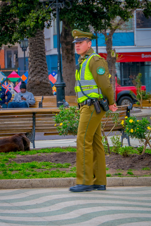 VALPARAISO, CHILE - SEPTEMBER, 15, 2018: Outdoor view of police standing in the park usually called as carabineros in this part of latin america in Valparaiso Chile