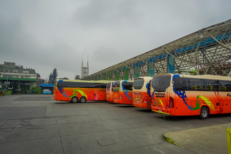 SANTIAGO, CHILE - SEPTEMBER 14, 2018: Outdoor view of buses parked in a row inside of the terminal at the platforms at Alameda station. This is the largest and primary bus terminal of the city Éditoriale
