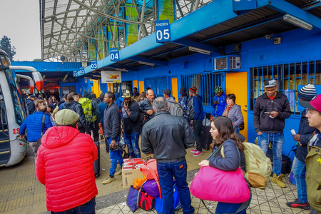 SANTIAGO, CHILE - SEPTEMBER 14, 2018: Unidentified people waiting inside of the terminal the buses at the platforms at Alameda station. This is the largest and primary bus terminal of the city Éditoriale