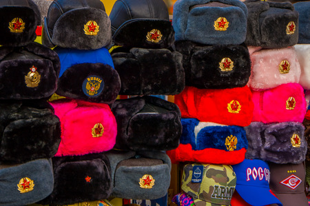 MOSCOW, RUSSIA- APRIL, 24, 2018: Blurred view of assorted Russian winter hats made from rabbit fur, located in a store in the streets of Moscow