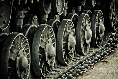 Close up of blurred tank wheels located at historic cultural complex called Stalin Line fortifications along the western border of the Soviet Union in Minsk Imagens