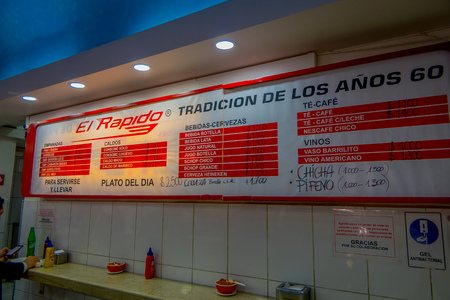 SANTIAGO, CHILE - SEPTEMBER 14, 2018: Inside view of restaurant with the menu in the wal with prices of the food that restaurant offer for people Editorial