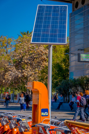 SANTIAGO, CHILE - SEPTEMBER 13, 2018: Close up of solar panel to recharge the bikes parked in the center of the city in Santiago, Chile