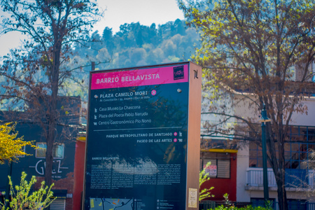 SANTIAGO, CHILE - SEPTEMBER 13, 2018: Outdoor view of informative sign of museum la Chascona, square of Pablo Neruda and gastronomic center Pio Nono in Bellavista neighborhood in Santiago
