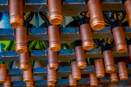 SANTIAGO, CHILE - SEPTEMBER 13, 2018: Close up of selective focus of bottle of wines updown position inside of a restaurant in Lastarria neighborhood located in Santiago of Chile