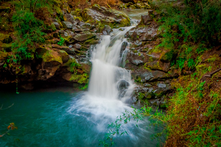 Beautiful outdoor view of long exposure of gorgeous waterfall located at Pucon, Chile