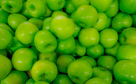 Fresh green apples background. Green apples texture. Fruit in Supermarket Stock Photo