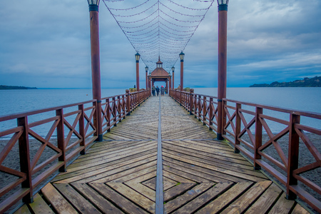 Beautiful outdoor view of wooden pier of Frutillar, southern Chile