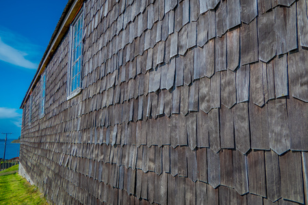 Close up of wooden exterior facade with window of church of Vilupulli, is a catholic temple in the locality of Vilupulli, in Chonchi, Chilo , south of Chile