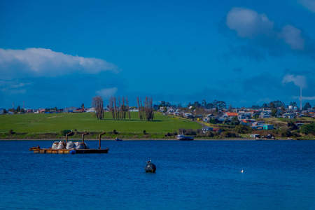 Outdoor view of building sin the horizont located in Chiloe island, Chile Stock Photo